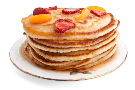 stack of pancakes with syrup and fruit photo