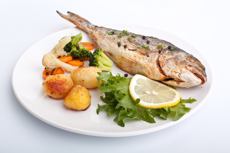 sea bream: Sea Bream fish with vegetables on white plate
