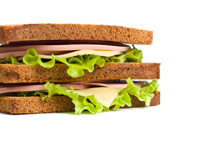multi grain sandwich: whole wheat  sandwiches with meat,cheese and lettuce on white plate Stock Photo