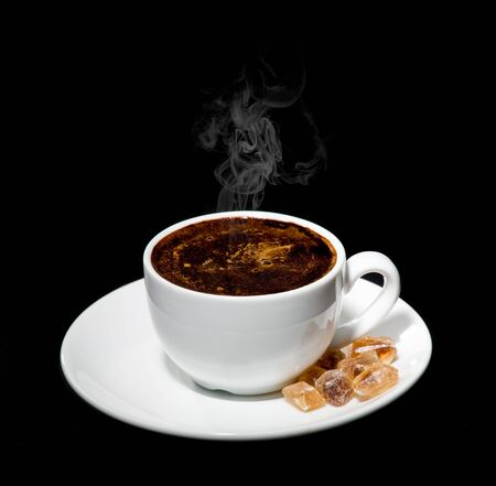 Cup of black coffee with sugar on black background