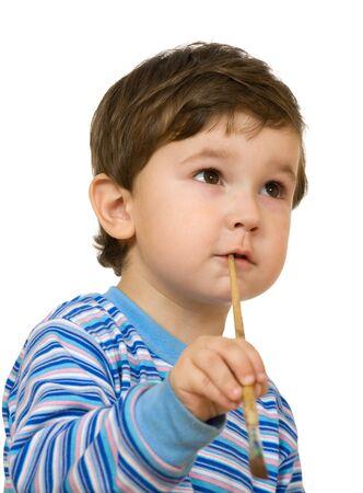 portrait little boy with brush