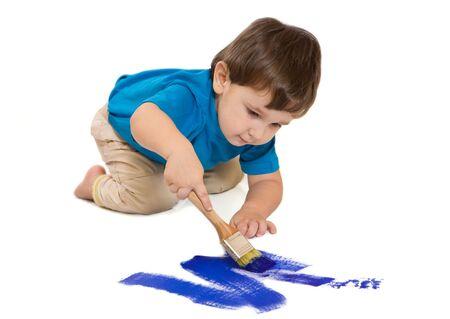 Boy draws dark blue a paint photo