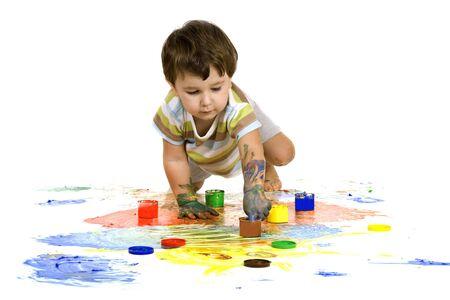 A little boy draws hands on the floor Stock Photo