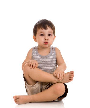 little boy does exercises on yoga