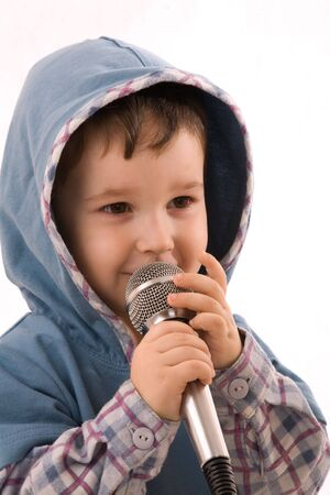 The child with a microphone on a white background Stock Photo