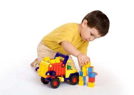 jongen, vrachtwagen en blokken Stockfoto