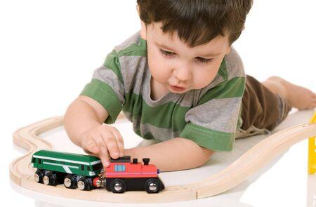wood railroads: boy playing with a train set