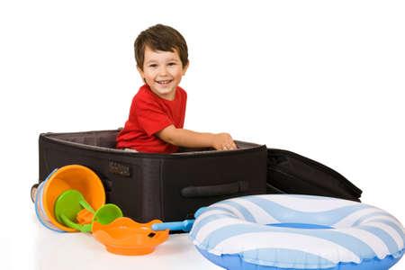ittle: ittle boy packs a suitcase