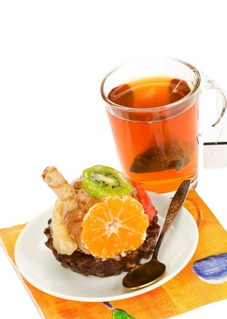 beautiful  cake with fruit against a cup of tea Stock Photo - 6209109