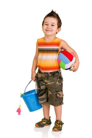 little boy with toys on a white background Stock Photo