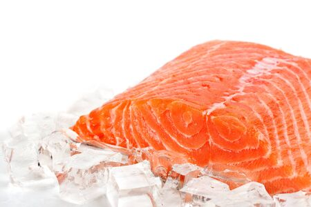 Red fish with ice slices on a white background Stock Photo