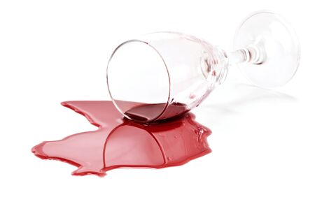 Spilled red wine glass isolated on white background