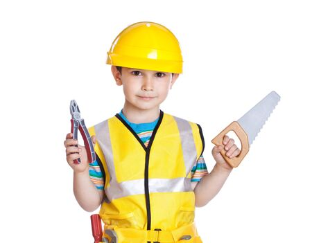 Little boy in builders uniform with tools, isolated on white