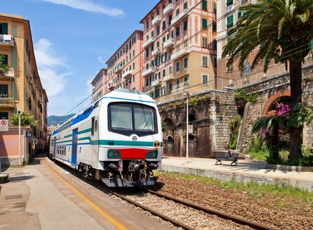 Two-storeyed train at railway station in ?amogli. Italy, Liguria.
