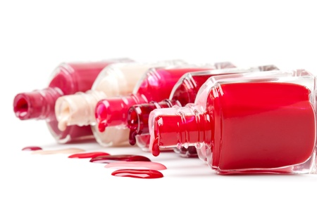 bright-colored nail polish spilling from bottles Stock Photo