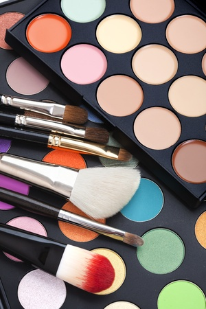 set colorful of makeup pallet with makeup brushes photo