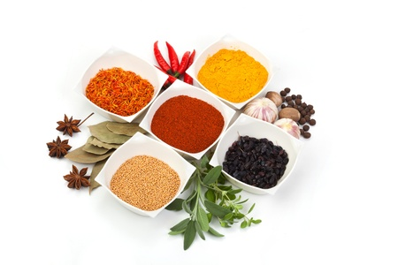 curry powder: Variety of different spices on white background Stock Photo