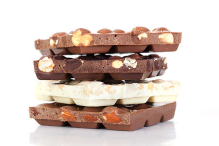 deliciously: Closeup hocolate bar with nuts on white background