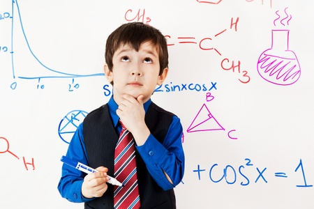 Ð¡hild prodigy in meditations at chalkboard
