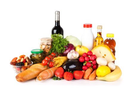 Groceries including vegetables, fruits, bakery and dairy products, wine isolated on white photo