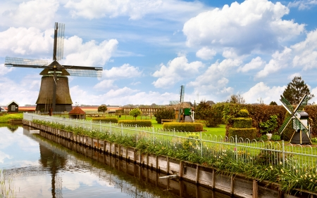 Beautiful landscape of the Netherlands with a windmill photo