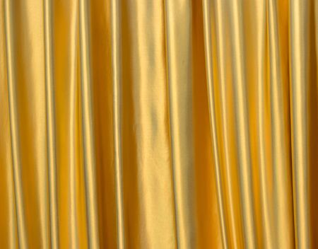Background of golden satin fabric photo