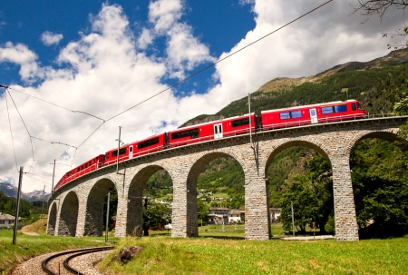 viaduct: Swiss mountain train Bernina Express Stock Photo