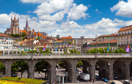 LAUSANNE, SWITZERLAND - JUNE, 20  2012  View of Grand-Pont Bridge and Notre-Dame Cathedral of Lausanne