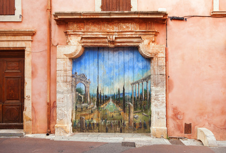 roussillon: ROUSSILLON, FRANCE - JULY 2: Beautiful picture in the doorway of Roussillon, Provence, France on July 2, 2014. Editorial