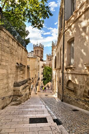 MONTPELLIER, FRANCE - MAY 27, 2014: The street leading to the Saint Pierre Cathedral on May 27, 2014 in Montpellier, France