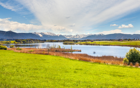 Beautiful panoramic landscape of Bavaria with its lake and Alpine mountains in the spring
