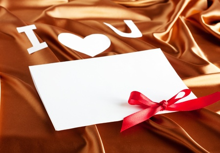 Card with I love you on gold silk background photo