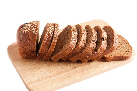 Fresh whole grain bread close up. Isolated on white photo