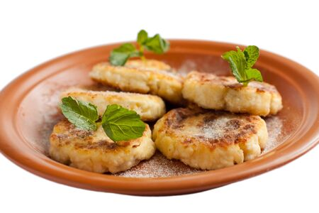 Sweet fried cheese pancake with powdered sugar  Isolated on white photo