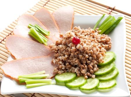 Buckwheat with ham and vitamin herbs for breakfast  Stock Photo