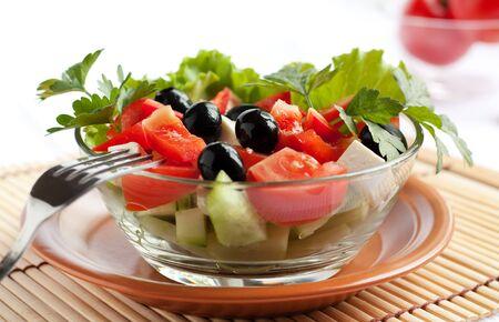 Juicy Greek salad in  glass salad bowl. photo