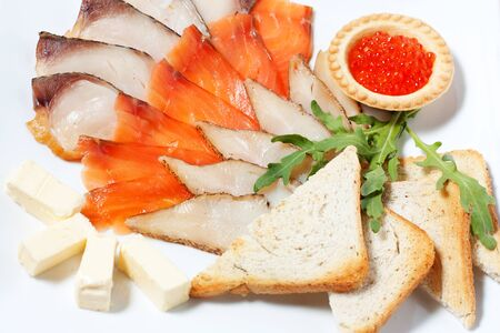 Рlate with bread, salmon and fish of different. photo