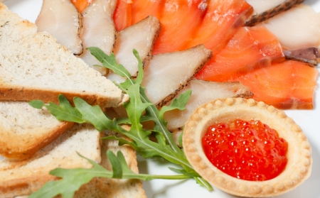 Slices of smoked fish on a plate and red caviar Stock Photo - 13859599