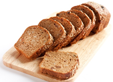 Bread from wheat flour, whole grain bread. Cut into pieces photo
