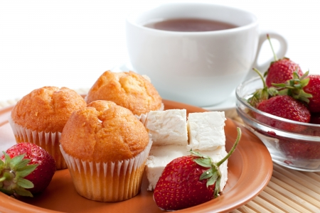 Sweet breakfast or dinner: strawberry, cream cheese, muffins and tea. Stock Photo - 13981210