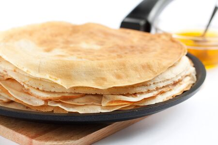 Pancakes in a frying pan  Fresh, delicious dessert photo