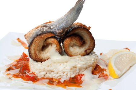 Fried fish and steamed rice with tomato sauce photo
