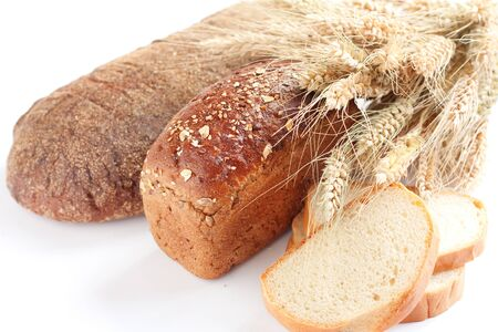 Spikes of wheat and different kinds of bread photo