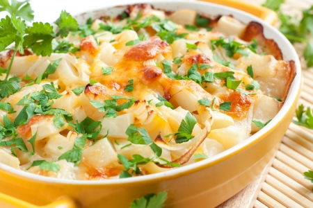 Рotato gratin with cheese and parsley Stock Photo