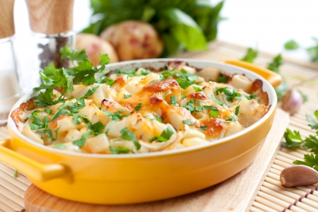 baked potato: Appetizing gratin  in the yellow form for baking