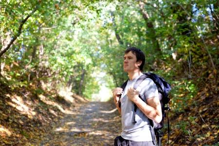 ecotourism: Man tourist admires the beauty of the autumn park