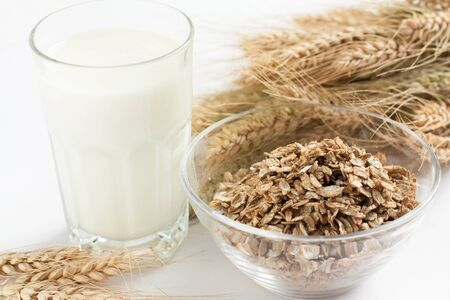 Glass of milk and oatmeal, close up Stock Photo