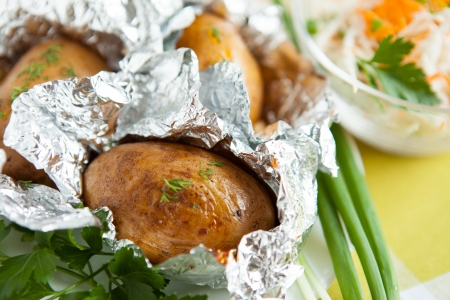 Jacket potatoes cooked in foil, and greens Stock Photo - 16170337