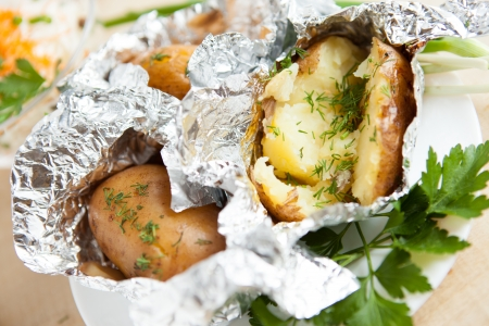 Potatoes baked in foil, close up Stock Photo - 16170336