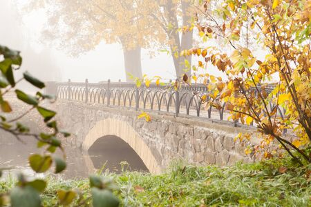 Autumn Landscape with an old stone bridge, nature photo